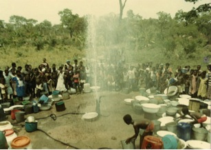 Figure 2. The inhabitants of the village of Oku Junction waiting patiently to fetch their first bucket of clean water after the completion of well development.